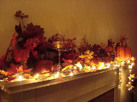 fall mantle. Gets a head start on getting some of my white Christmas lights out too!
