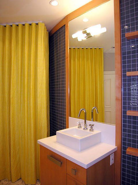 Bathroom suite ideas with white sink bowl, yellow shower curtain and brown cabinet,