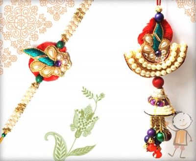 Bhaiya Bhabhi Rakhi, Rakhi Store: - Buy #Bhaiya #Bhabhi #Rakhi #Online On #Rakhi Festival 2015. Handcrafted Pearl Bhaiya Bhabhi Rakhi, surprise your loved ones with roli chawal, chocolates and a greeting card as it is also a part of our package and that too without any extra charges. http://www.bablarakhi.com/send-family-rakhi-online/655-send-handcrafted-pearl-bhaiya-bhabhi-rakhi-online.html