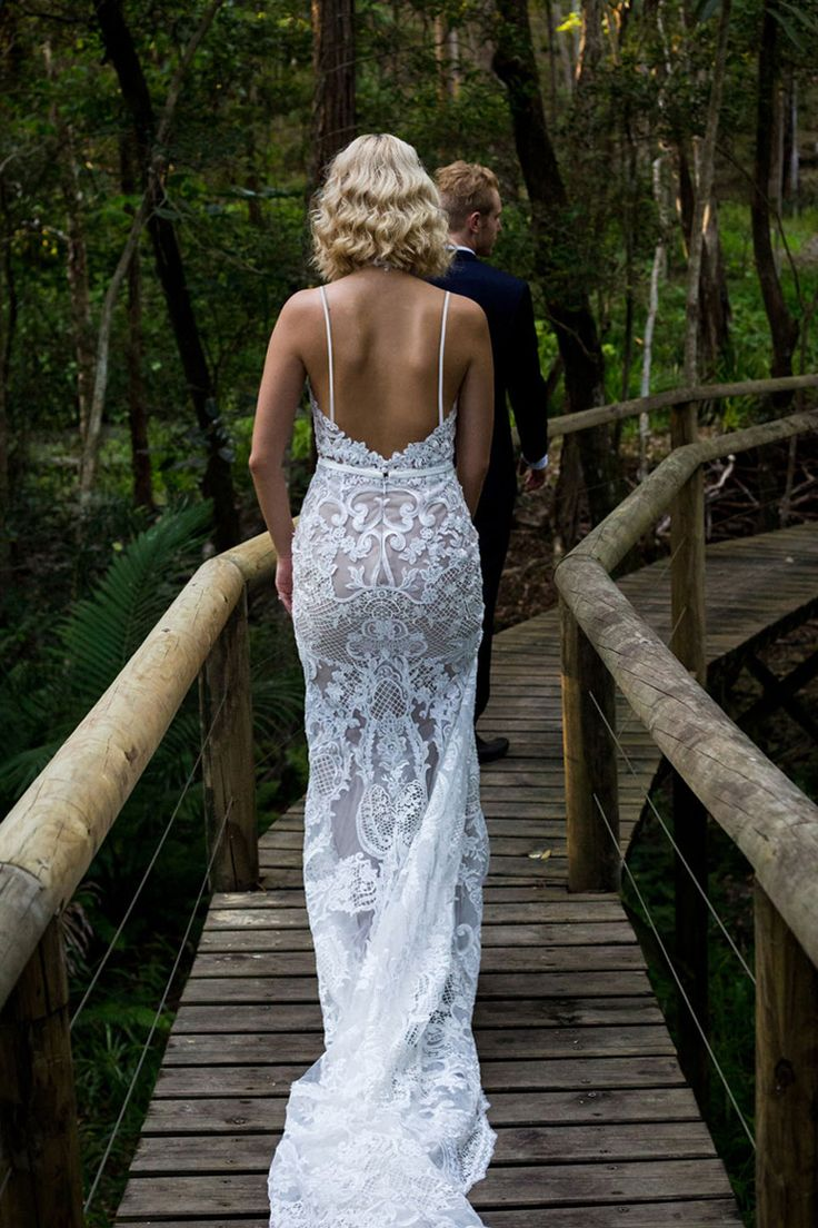 Modern lace wedding dress with spaghetti straps and train | Lee Calleja Thomas Photography