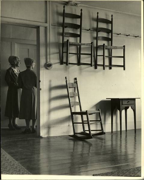 """Nina Leen, Canterbury, New Hampshire, 1776 - 1850"" Shaker Chairs Timber. Slat back rocker, with what appear to be woven seats"