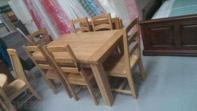 Solid Oak table and 6 chairs (New) - Solid Oak table and 6 chairs (New). Really heavy. ...