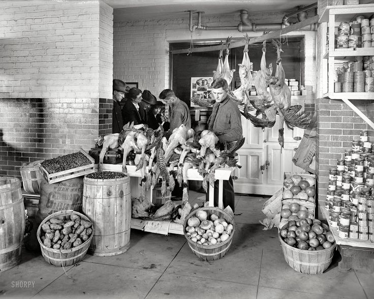 Shopping for Thanksgiving dinner, 1924 - Turkeys stacked on a wooden counter, wood baskets and barrels hold produce <> (Shorpy Historical Photo archive, history, old wood)
