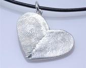 half your fingerprint, half his. love it.