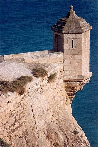 Moorish Castle of San  Jose which appears to hang off the cliff in  Guadalest,  Alicante,