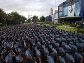 © Provided by GMA News Online Hundreds of policemen gather in Camp Crame, the Philippine National Police's national headquarters in Quezon City, before their deployment for the New Year's Eve revelry. PNP Photo At least 6,000 policemen will secure Batasan Pambansa Complex while...