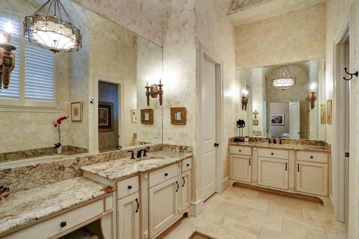 This Spacious Master Bathroom Features Two Separate Vanity Spaces