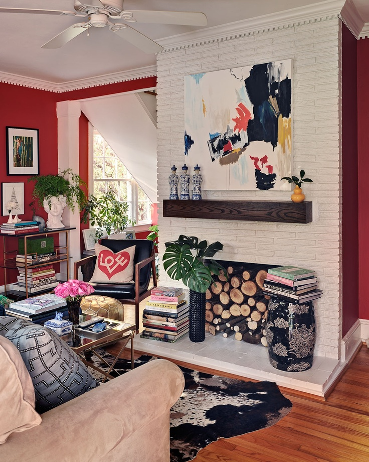 white brick. moldings. fireplace logs. pops-o-color. yes.