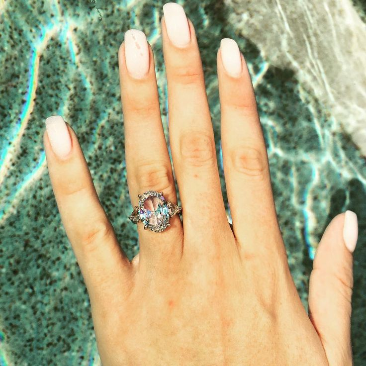 INTA Gems & Diamonds, Nicole Johnson's ring; the center is a pool representing the pool of love and each side stone is shaped like rain drops that continue to fill the pool https://www.instagram.com/p/BCEIqJan41K/?taken-by=nicole.m.johnson&hl=en