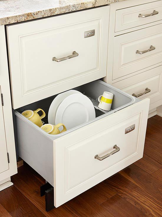 Like traditional dishwashers, dishwasher drawers can be concealed behind cabinetry panels, too. Outfit the drawers with the same hardware as surrounding cabinets to create an entirely seamless look.