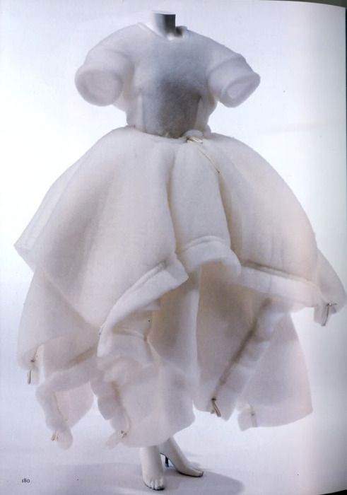 Comme des Garçons. Female Japanese designer Rei Kawakubo designed for Comme des Garcons during the 1990's, largely utilizing distressed fabrics to display the belief that clothing is an ever-changing product of its sociocultural environment.