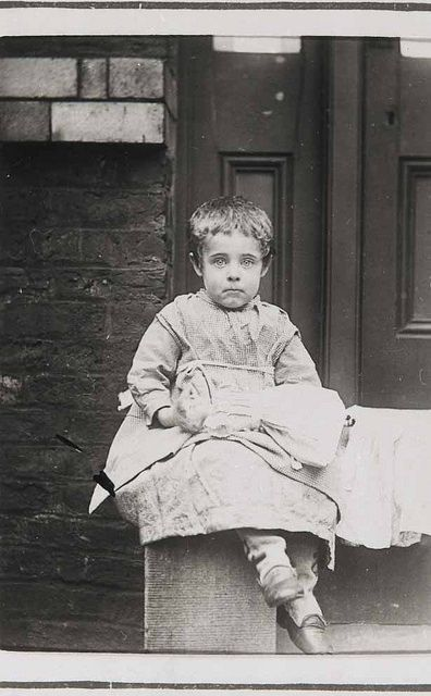Child at Crumpsall Workhouse, c.1897 The sadness in this child's eyes.