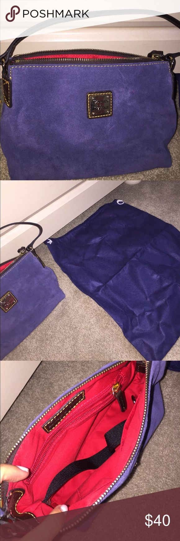 Dooney and bourke navy purse Never used! Comes with bag to protect purse Dooney & Bourke Bags