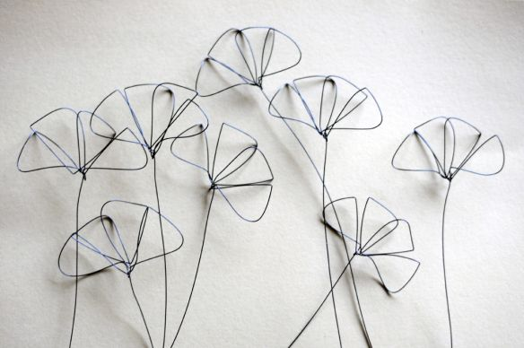 Poppies made with wire.  Check out the other fun designs on this blog.