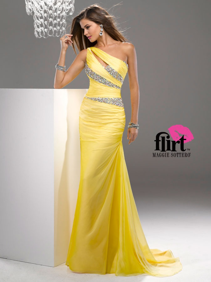 Show off your amazing figure in this form fitting style to make a statement. This draped chiffon Maggie Sottero Flirt prom dress P4717 has one shoulder neckline with keyhole opening, ruched torso, and asymmetrical panels of rhinestone. Completing this look is a trumpet skirt. This prom dress comes in these colors: lemon meringue, purple passion and poppy. Wear this gorgeous dress and you will be the envy of the evening. Add chunky rhinestone earrings and matching bracelet to stand out in the…