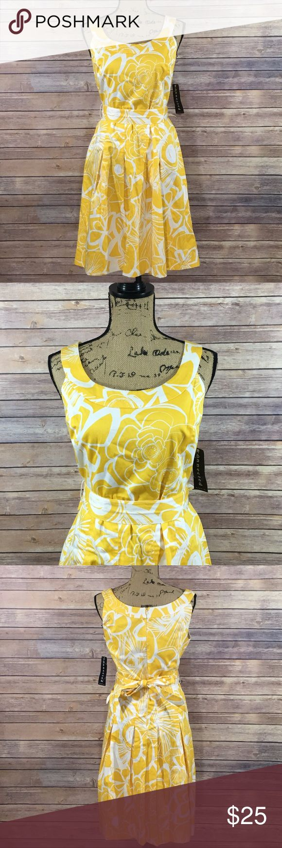 Connected Apparel Dress NEW Size 12 Connected Apparel Dress Yellow and White Print Comes with belt Brand New With Tags Connected Apparel Dresses