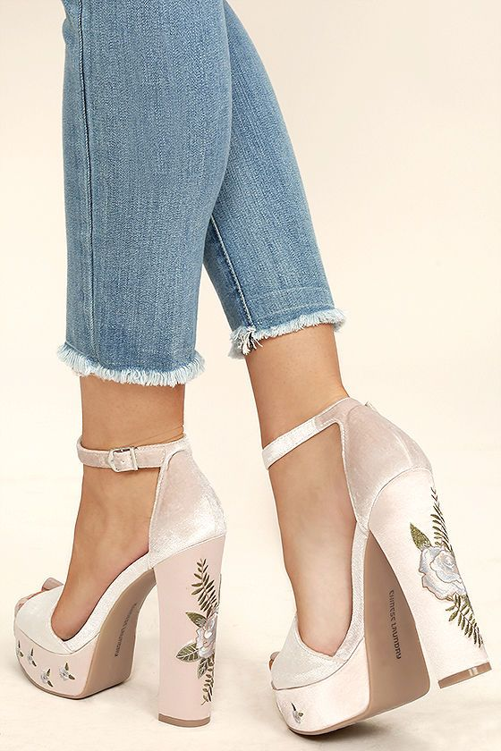 We are all singing the praises of the Chinese Laundry Ariana Nude Velvet Platform Heels! These stunning platforms have a velvet peep-toe upper, and matching heel cup with adjustable ankle strap (and gold buckle). Blue and green floral embroidery completes this bold look!