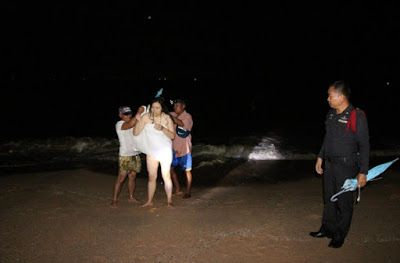 Photos/video: Jealous Wife Stripped And Stood Naked In The Sea In Protest After Her Husband Went Partying With His Work Mates