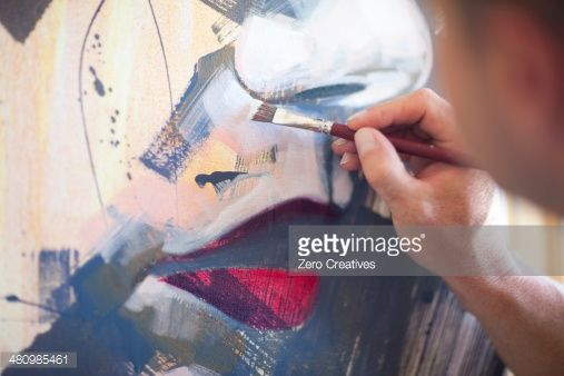 Stock Photo : Close up of mature male artist working on canvas