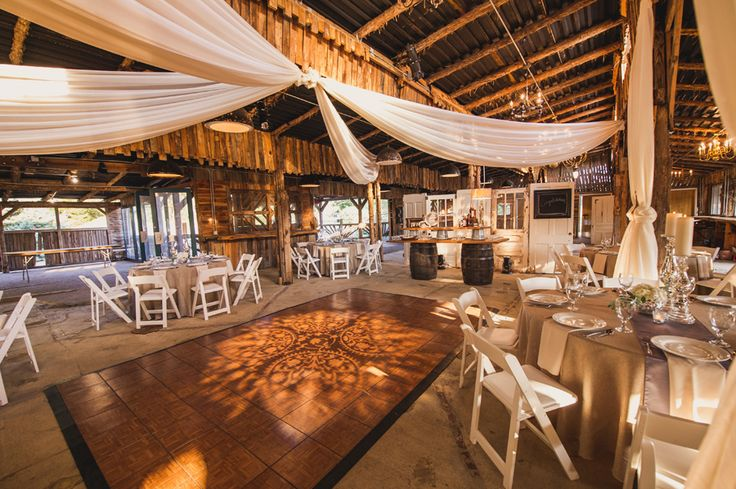 It would be awesome if we could find some kind of way to drape some fabric or even better lights over either the ceremony site or the table set up.