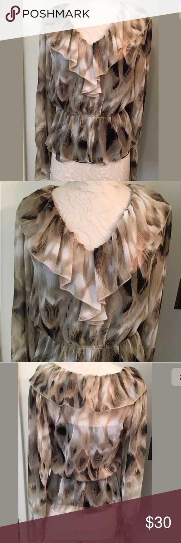 """Robbi Nikki tons of ruffles blouse Robbi & Nikki Size XS New without tags Boutique Price tag ($174) is still attached but Robbi & Nikki one has fallen off Top piece is 100% polyester chiffon Ruffles adorn it Underneath is an acetate cami Gorgeous   Measurements (flat/unstretched) Under arms across the back 18.5 at waist 22"""" stretches to 34"""" Shoulder to hem down back 22"""" robbi nikki Tops Blouses"""