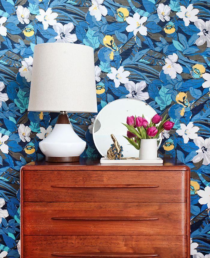 Bold floral print to add splash of feminine color and drama behind dresser.