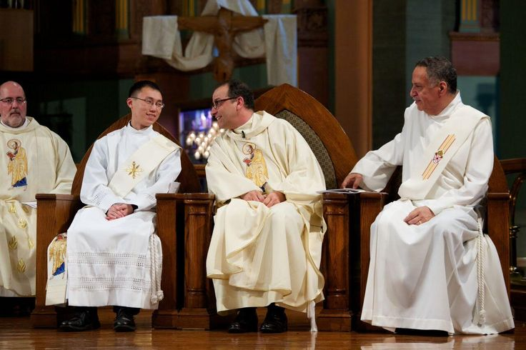 Paulist Fr. Eric Andrews (center) commenting to then-Deacon Jimmy Hsu during the Mass for Fr. Eric's installation as president of the Paulist Fathers.  (Jimmy was ordained a priest the next day.) Paulist Fr. Larry Rice is at left.  Deacon Wally Sandoval is at right.  Photo taken at our mother church, the Church of St. Paul the Apostle, in New York City.