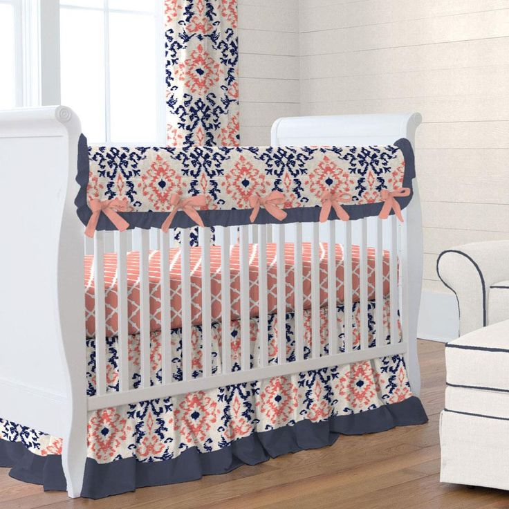 Navy and Coral Ikat Crib Bedding by Carousel Designs.