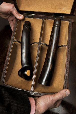 """Wooden phalluses - one measuring 10 inches and the other 11 inches. Staff at Brentwood Antiques Auction described the sex toys as """"extraordinary and exceptionally rare"""" and said they were probably French and dated back to the late 1700s."""