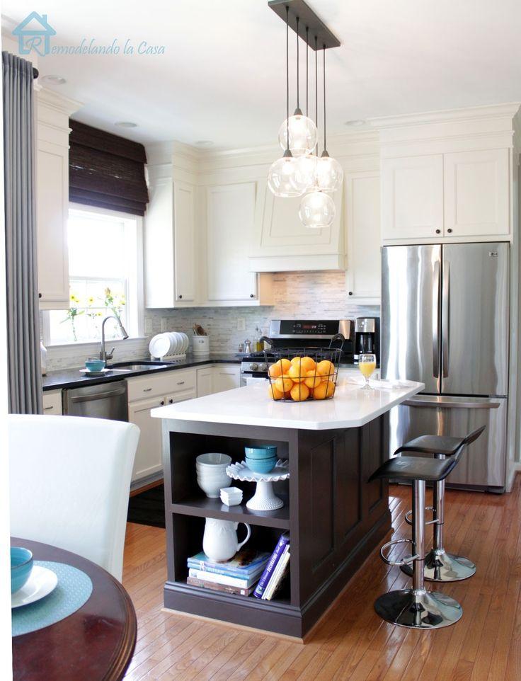 DIY - Kitchen makeover on a budget - shelf added to island, range hood, painted cabinets, fridge enclosure.