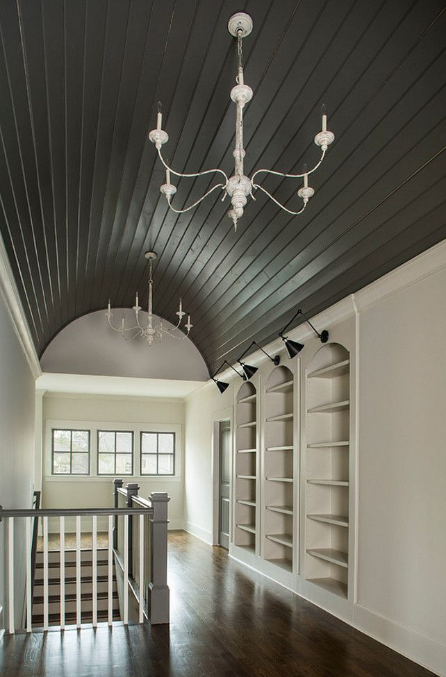 Hallway Bookcase ideas. Landing area with built-in bookcase and vaulted barrel ceiling. Vikki Werbalowsky from La Bella Vie.