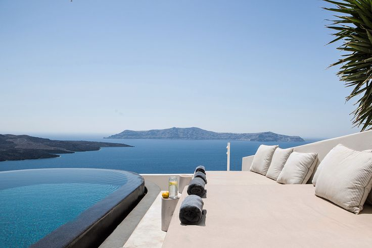 Black infinity pool out on the terrace in Santorini - aboratorium renovate seven suites at Porto Fira luxury hotel in Santorini, Greece. Luxury hotel designs feature on the www.martynwhitedesigns.com interior design blog.