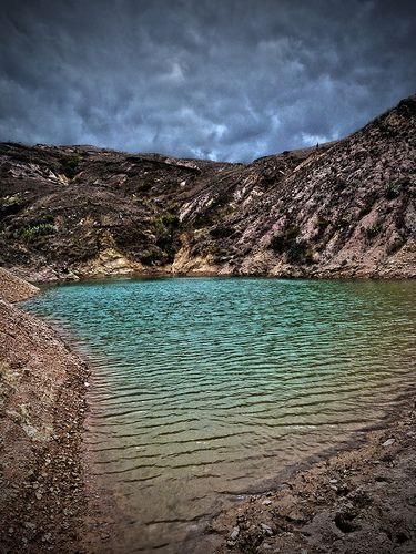 Sachica, Boyaca, Colombia Lake in the middle of the sand and rock mountains | by gonzomanxx