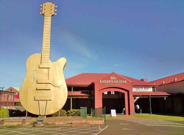 Famous Big Golden Guitar Outside The Tourist Centre At Hillvue In Australia