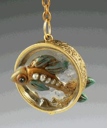 Fish swimming through resin on this necklace pendant by Christi Friesen - very cool!