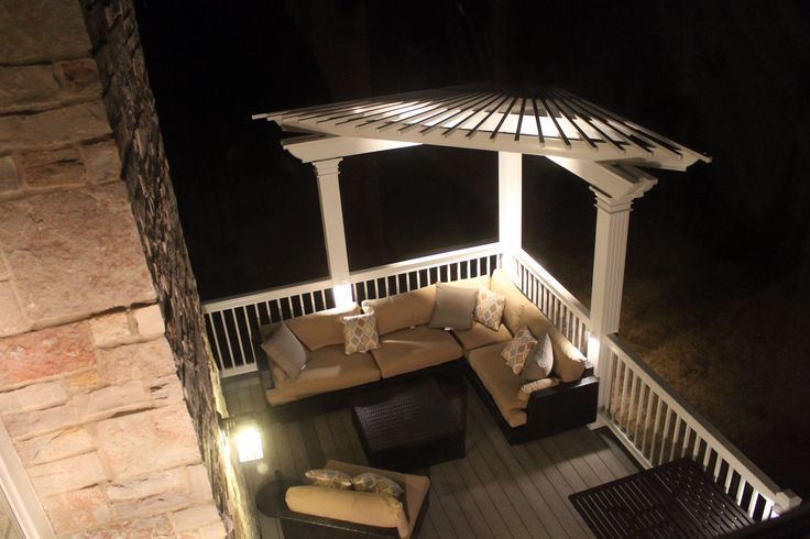 Custom triangulated Coolbreeze aluminum pergola with built in lighting.