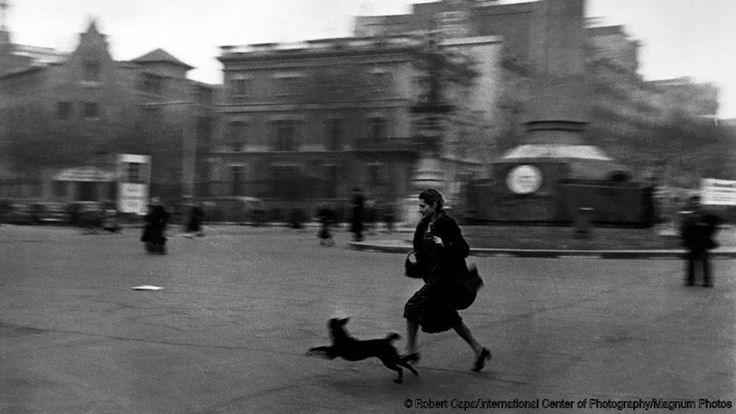 Horror of war... The publication of The Falling Soldier in Life magazine exposed the cruel bloodshed of the Spanish Civil War - and made Capa famous. His fiancee Gerda Taro was killed in the conflict in 1937, but Capa remained in Spain. In Barcelona 18 months later, he photographed this woman running for shelter because of an air raid by Franco's forces.