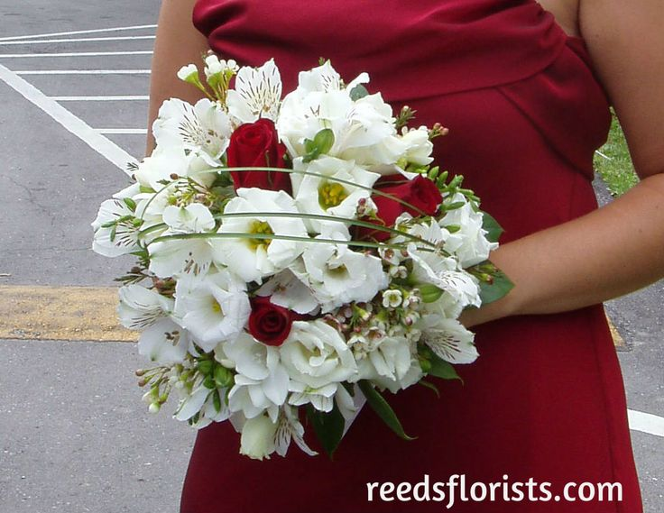 Beautiful Bridesmaid's Bouquet perfectly compliments her stunning red dress. Flowers by www.reedsflorists.com