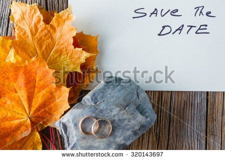 Handwritten words Save the date on paper with fall background, wedding card