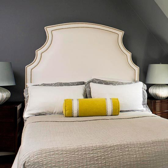 bridge the gap: nailhead trim bridges the chasm between the brightness of the headboard & the steely gray undertones of the wall (ideas for jenn's bedroom)