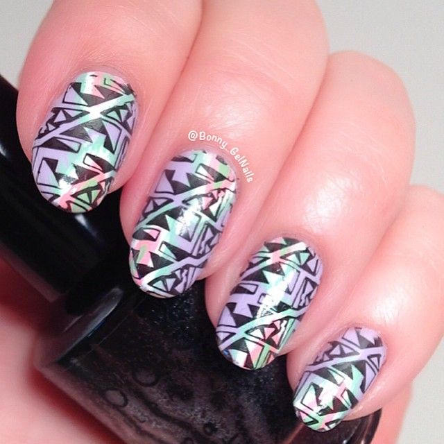""""""".....and then I stamped on it so it could represent Tribal for #Clairestelle8April  Products used: . . . . . . . . . . . . . . . .  Polish: Covergirl outlast lav-endure by @covergirl ikat design: acrylic paints Stamping plate: Pueen Fireworks Festival by @pueencosmetics  Stamping polish: Yoga Pants by @dripdropnailpaint  Topcoat: H K Girl by @glistenandglow1"""" Photo taken by @bonny_gelnails on Instagram, pinned via the InstaPin iOS App! http://www.instapinapp.com (04/12/2015)"""