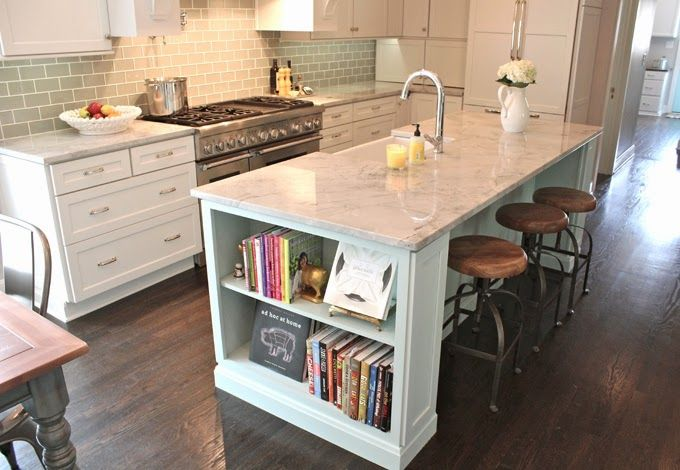 Guehne-Mades Kitchen resources Decora cabinets, island paint SW Tidewater, white cloud quartzite counters, walnut counter by GIM, backsplash Dal-Tile 3x6 in feather white