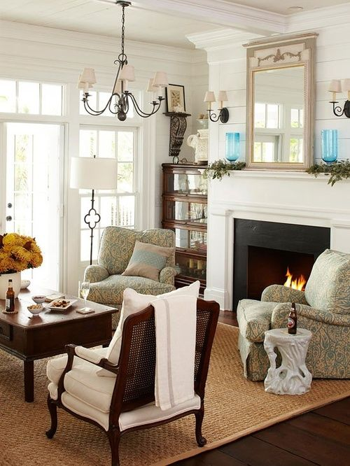 Oh my gosh...I just want to sit at that table in front of the fire and put a puzzle together, or curl up in one of those comfy chairs with a book. What a cute space!!