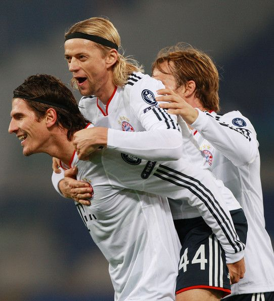 Mario Gomez (L) with his teammate Anatoliy Tymoshchuk #44 and Andreas Ottl (R) of FC Bayern Muenchen celebrates after scoring the second goal during the UEFA Champions League Group E match between AS Roma and FC Bayern Muenchen at Stadio Olimpico on November 23, 2010 in Rome, Italy.