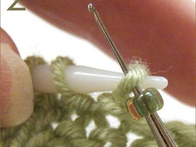 Adding beads to knitting. Much easier than stringing it all on at once! But also gives a different look.