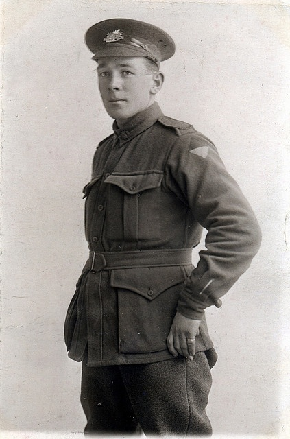 """Pte """"Reg"""" A.I.F.  Australian private in England sometime during the Great War. 2nd Division, possibly 25th Battalion (difficult to discern colours of shoulder flash in b & w image). Of note is the soldier's """"wound stripe"""" on his left cuff."""