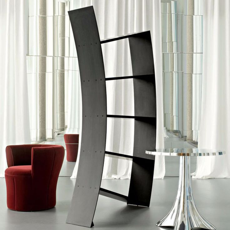 Virgo bookcase by Driade. Virgo, designed by Xavier Lust for Driade, is a bookcase with a structure that remember the energy of a tightrope. Black anodised aluminum structure and shelves.
