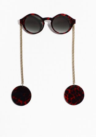 Intriguing sunglasses with a rounded front and chain temples to be placed behind ears.    Read more about our sunglasses here.