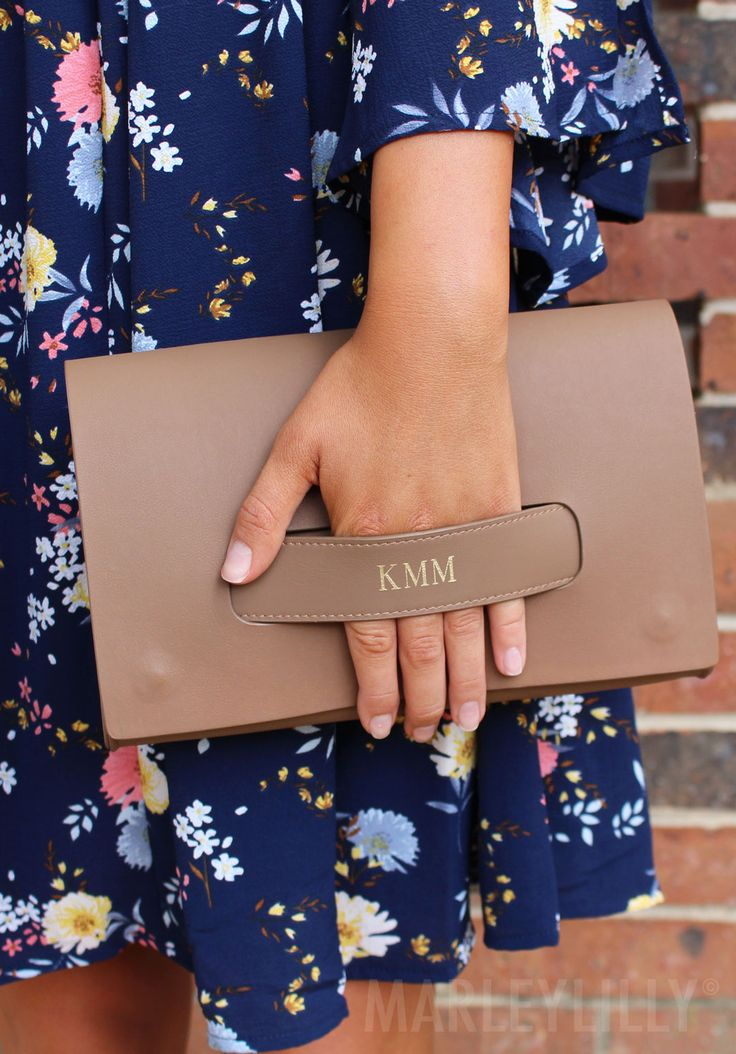 Stand out with our new Monogrammed Clutch! Stylish & sleek! Shop now at https://marleylilly.com/product/monogrammed-clutch/