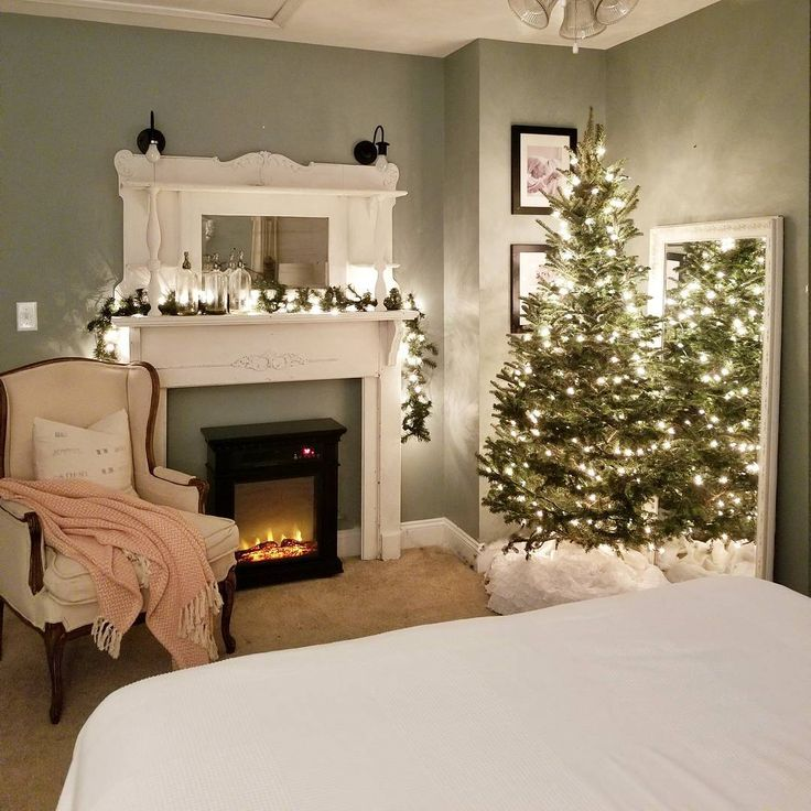 Christmas tree in bedroom. Fire place in bedroom. Antique fire place in bedroom.